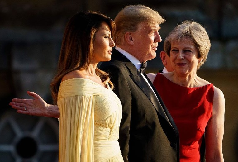 Caption Competition: 'We are at a stand off Mrs May. You may be reaching for Melania's on switch but I have a Secret Service man behind you ready to press your off switch first'